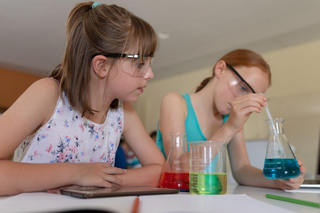 Two elementary school girls in chemistry class